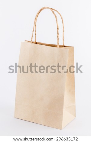 Blank brown paper bag isolated on white background - stock photo
