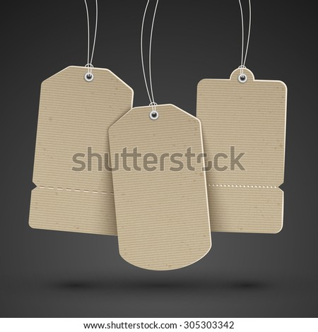 blank brown price tags hanging on the black wall