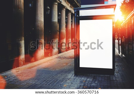 Blank bus stop billboard with copy space screen for your text message or promotional content, advertising mock up outdoors, clear poster in urban setting, empty public information board on the street - stock photo