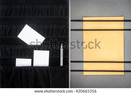 Blank business card in file folder - stock photo