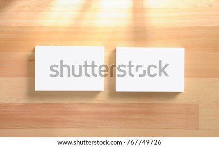 Blank business card stacks on wooden background. 3d render.Template to showcase your presentation.
