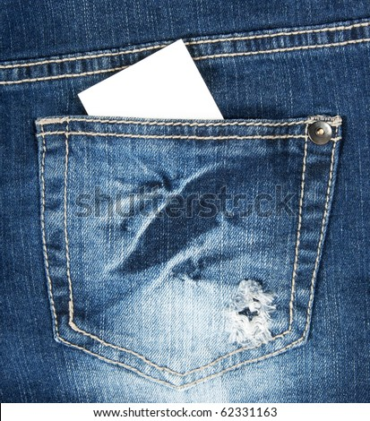 Blank business card with copy space in a pocket of blue worn out jeans. - stock photo