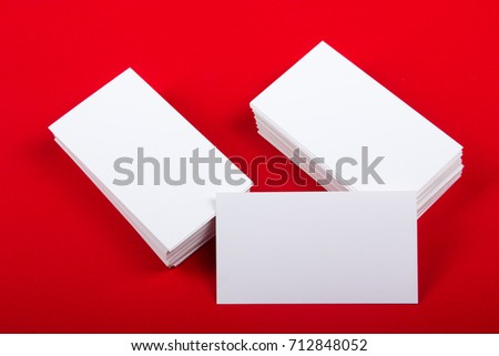 Blank business cards at red textured background. Template for ID. Top view