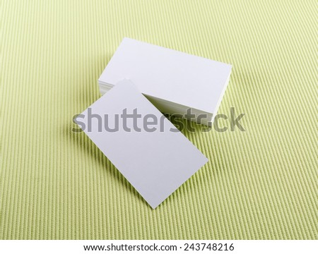 Blank business cards on green background. Template for ID. - stock photo