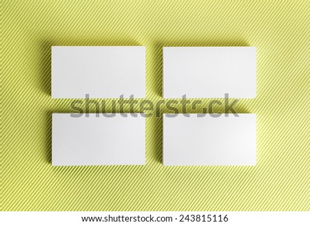 Blank business cards on green background. Template for ID. Top view. - stock photo