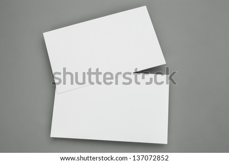 blank business cards on grey background, good for texte & logo - stock photo