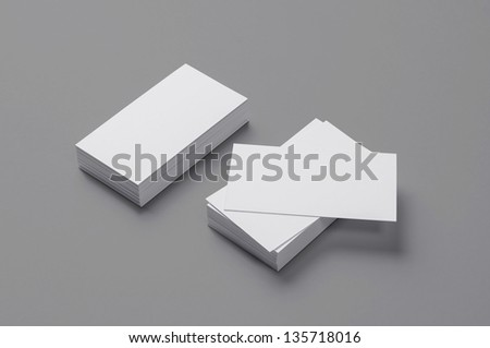 Blank Business Cards on isolated on grey background with soft shadows - stock photo