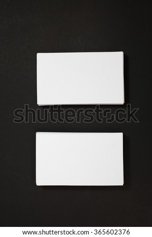 blank business cards stack up on Black background