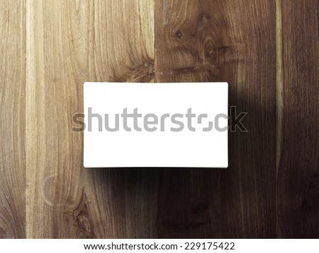 blank business cards stack up on wooden table, 3d render - stock photo