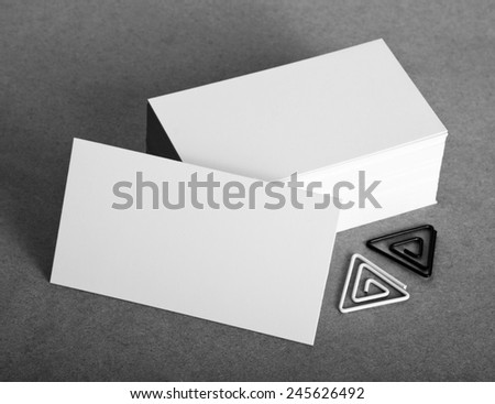 Blank business cards with clip on crafts background, identity design, corporate templates, company style - stock photo