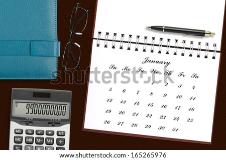 blank calendar in notebook with stationery on the desk for your plan - stock photo