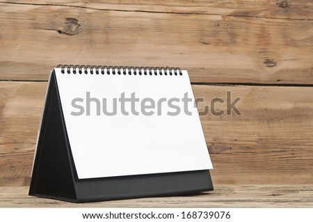 Blank calendar on wood table  - stock photo