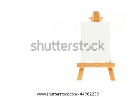 Blank canvas on an easel with copy space to the left