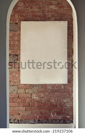 Blank canvas on rustic brick wall add your own art - stock photo
