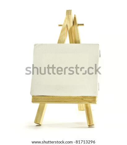 blank canvas on wooden easel over white - stock photo