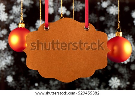Blank card, Christmas baubles and snowflakes on black background