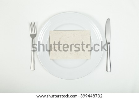 Blank card on plate - stock photo