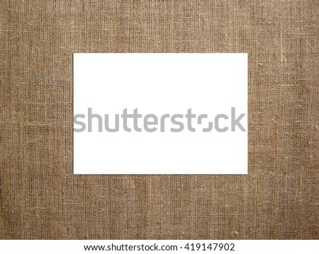 Blank card with on canvas. Mockup to display your artworks. - stock photo