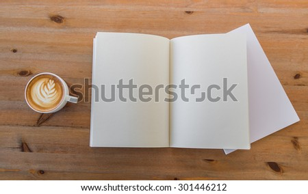 Blank catalog, magazines,book mock up on  wood background with cup of coffee - stock photo