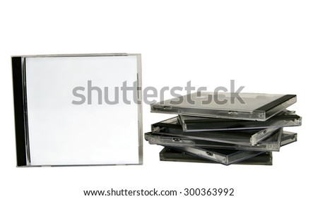 Blank CD cases stacked with one standing/ Stack Of CD Cases - stock photo
