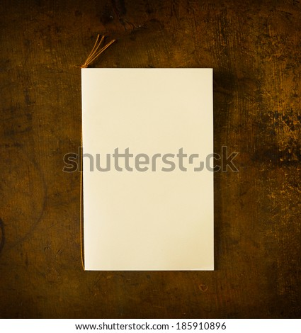 Blank ceremony, wedding or a party invitation card on old wooden grungy desk.   - stock photo