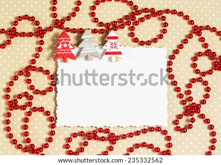 Blank christmas greeting card with small decorative clothespins as firs - stock photo