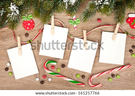 Blank christmas photo frames with fir tree and decor - stock photo