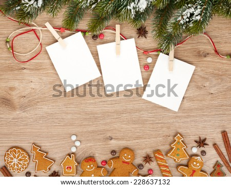 Blank christmas photo frames with fir tree and gingerbread cookies - stock photo