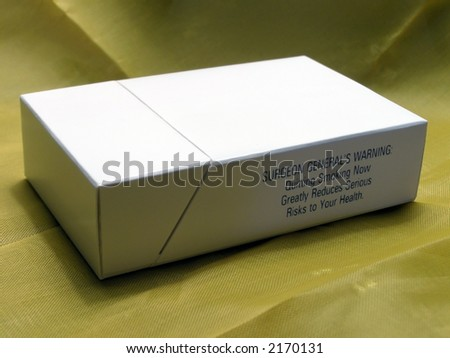 Blank cigarette pack on fabric background.
