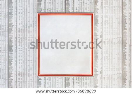Blank classified newspaper ad, in the middle of a financial page.  Red border. - stock photo