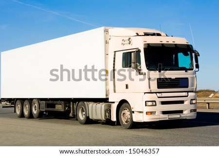 blank clean truck on blue clouded sky background - stock photo