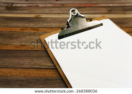 Blank clip on menu on wooden background - stock photo