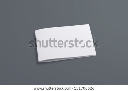 Blank closed horizontal magazine isolated on grey background with soft shadows - stock photo