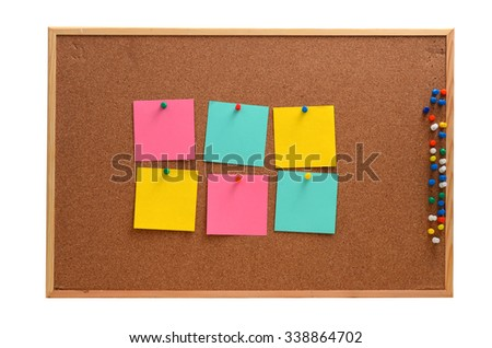 Blank, colourful notes pinned into brown corkboard