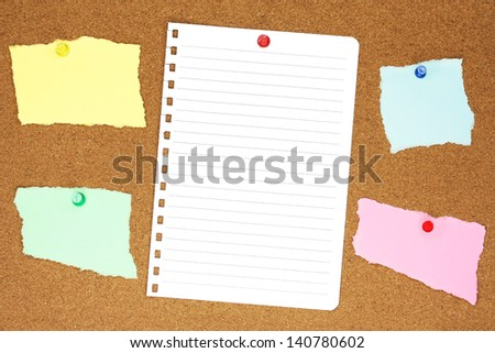Blank, colourful, ripped notes, pinned into a brown corkboard.   - stock photo