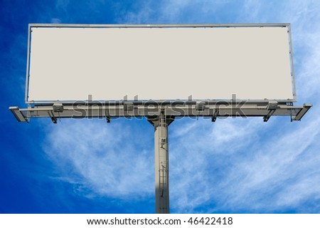 Blank commercial billboard against cloudy sky - stock photo
