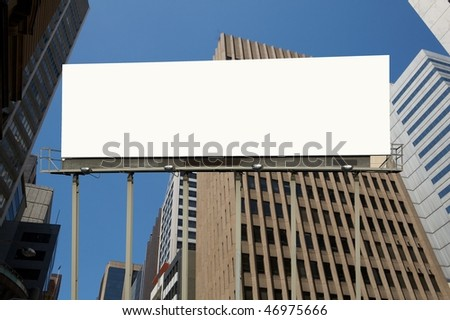 Blank commercial billboard city and tale building on background  background - stock photo