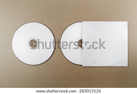 Blank compact disk on a table. Template for branding identity for designers. Top view. - stock photo