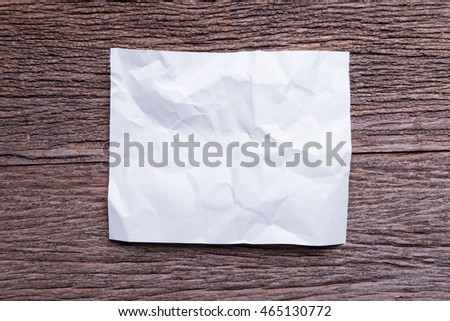 Blank crumpled paper on wood table