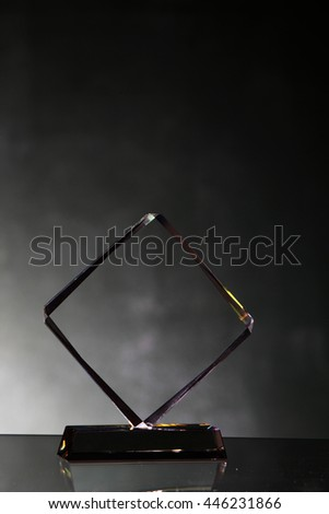 blank crystal trophy on the blackboard - stock photo