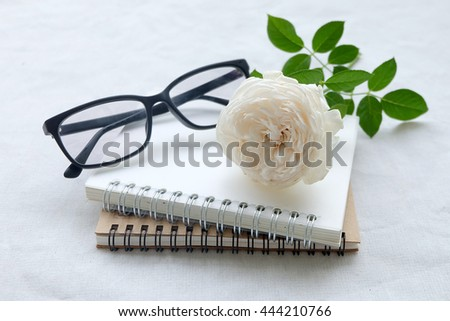 Blank diary,and glasses on white background  - stock photo