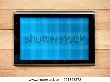 Blank Digital Tablet On Wooden Table