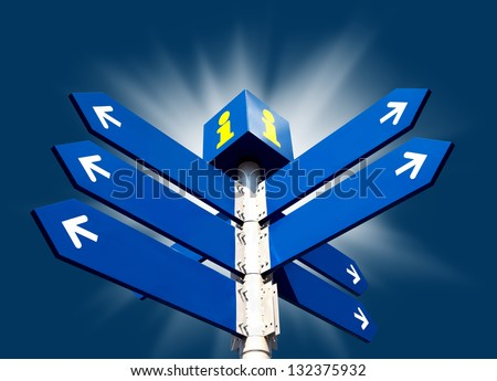 Blank directional road signs on blue background with sun beams - stock photo