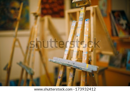 Blank easel in the studio - stock photo