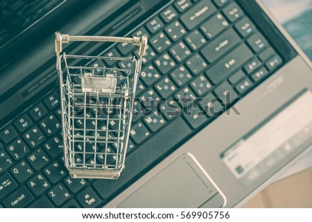 Blank Empty Shopping Cart On A Laptop Keyboard Ideas About Home Shopping Or Buying