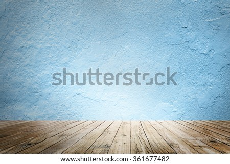 blank empty wall and floor in a blue color - stock photo