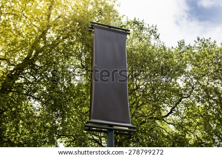 Blank exhibition sign with a copy space area hanged from a long pole - stock photo