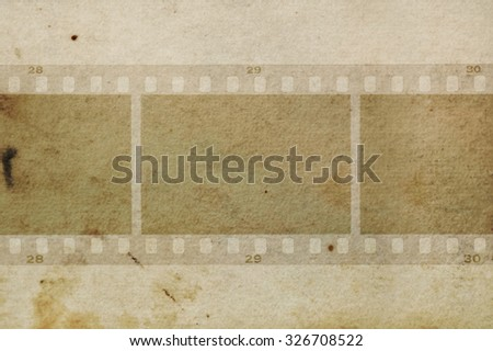 Blank film frames negative on grungy paper background texture. Design element. - stock photo