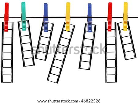 Blank film strips hanged on peg, isolated on white background - stock photo