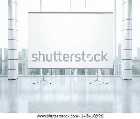 blank flip chart in bright office - stock photo